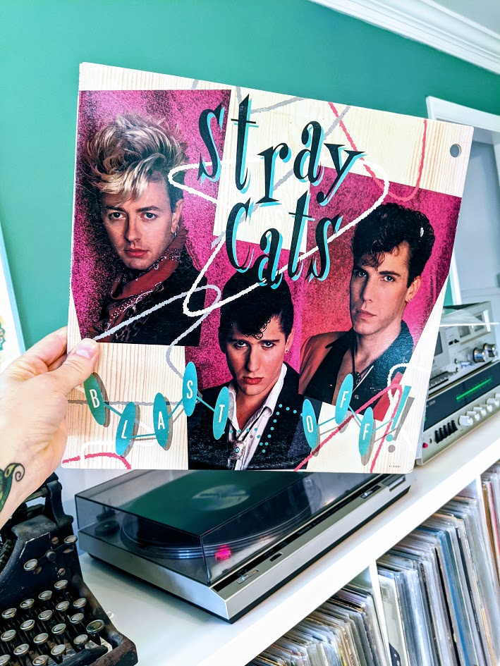 stray cats album cover with photos of each band member with big pompadour hair